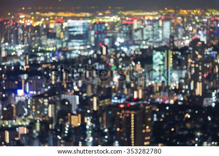Blurred bokeh multiple colours lights Tokyo city downtown background - stock photo