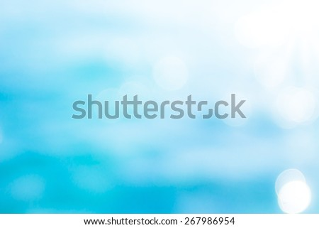Blurred bokeh sea water texture background. World Oceans Day, Peaceful, Religion, Nature, Environment, Ozone Layer, Health Care concept. - stock photo