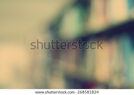 Blurred books on shelf in public library. Blured effect. Background for you pictures - stock photo