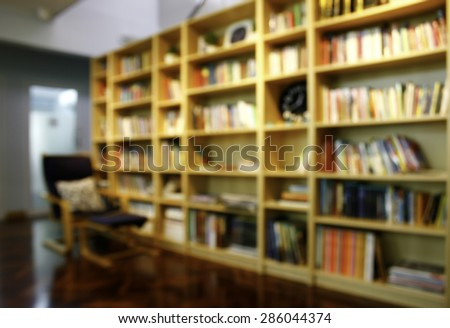 Blurred books on the shelf in public library. Blurred effect. Background for your pictures - stock photo