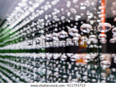 Blurred boutique with luxury products for the home. Beautiful interior decoration hanging threads of glass balls. Blurred bokeh basic background for design.