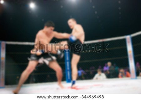 Blurred boxing fight. Abstract sports background with bokeh
