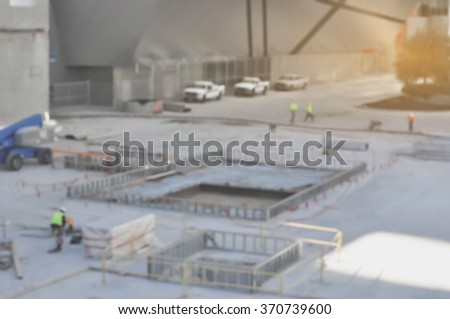 Blurred building under construction with workers - stock photo