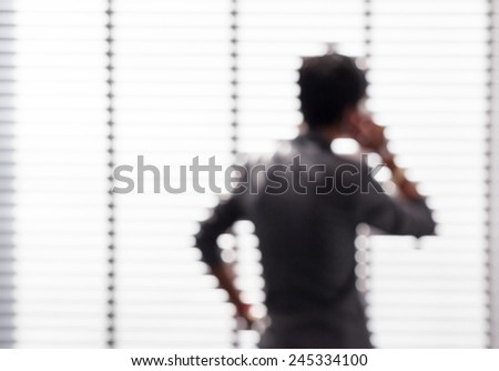 Blurred business man is seriously with his business under pressure situation in office building. - stock photo