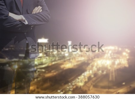 Blurred Business man success or soft Business man success in he working on marketing online or e learning with global learning and world on over blur or blurred night city view with light background.  - stock photo
