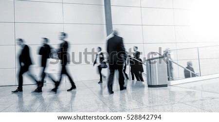 Blurred business people at a Trade Show floor