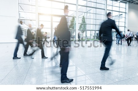 Blurred business people at a tradeshow hall