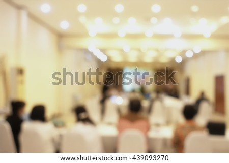 Blurred business people, men, women, in meeting room, discuss on marketing affair - stock photo