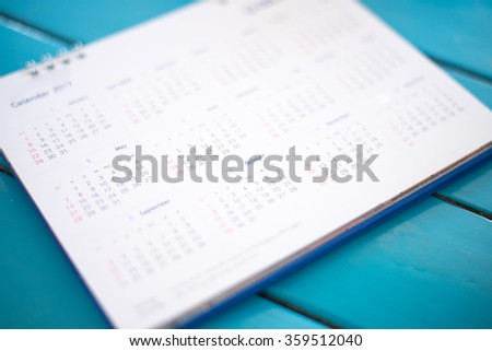 Blurred calendar page blue background. - stock photo