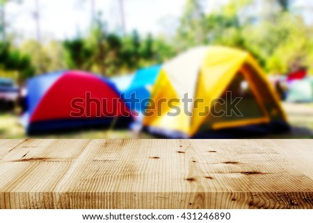 Blurred camping and tents in forest. - stock photo