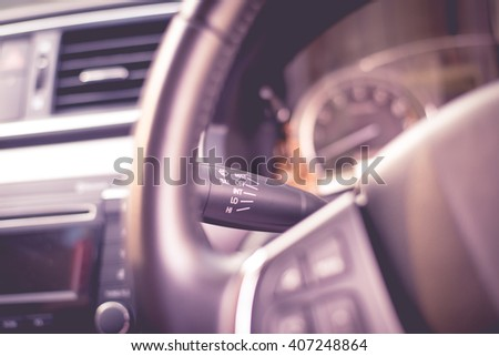 Blurred car Interior in pink tone.