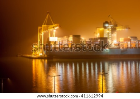 Blurred cargo ship and crane