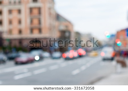 Blurred Cars in traffic at an intersection, city background. - stock photo