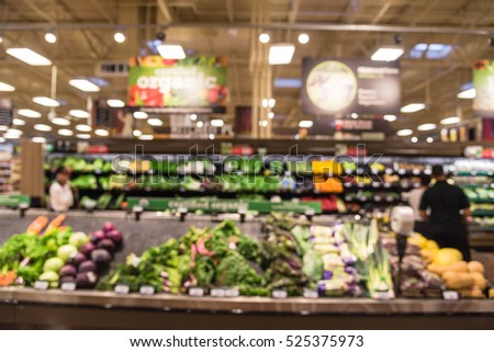 Blurred certified organic fresh produces, vegetable on shelves in local store  at Humble, Texas, US. Tomatoes, cucumber, green bean, carrot, onion, lettuce, kale and celery. Healthy lifestyle concept.