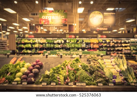 Blurred certified organic fresh produces, vegetable on shelves in local store  at Humble, Texas, US. Tomatoes, cucumber, carrot, onion, lettuce, kale, celery. Healthy lifestyle concept, vintage tone.