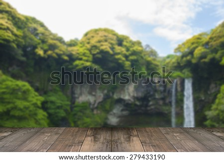 Blurred Cheonjiyeon Waterfall is a waterfall on Jeju Island, South Korea with wooden bridge. - stock photo