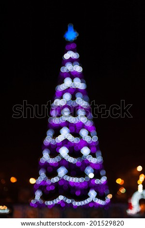 Blurred christmas tree lights on black background