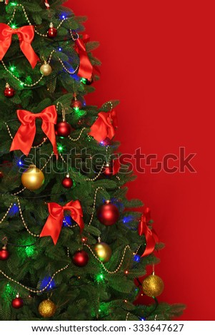 Blurred Christmas tree on red background
