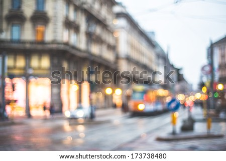 blurred city and people urban scene - stock photo