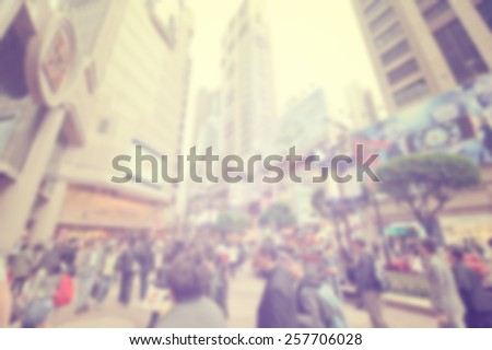 Blurred city background suitable as a background for text. Designed to work with most text colors including white. Artistic intent with filters and desaturation. Pedestrians among skyscrapers. Retro - stock photo