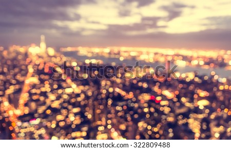 blurred city concept at blue hour. aerial view of New york city at sunset - stock photo