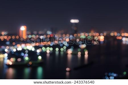 Blurred city lights bokeh illuminate at night - stock photo