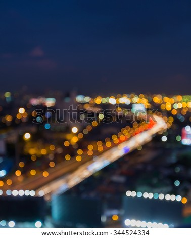 Blurred city road curved background at night - stock photo