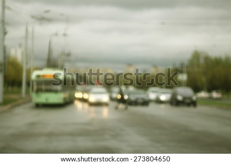 Blurred city roadway with cars - stock photo