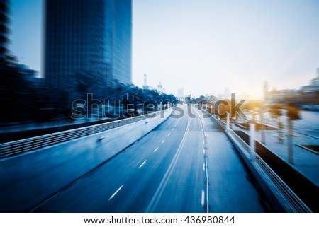 Blurred clean road with modern buildings background