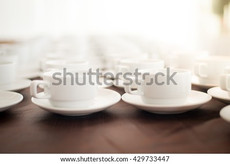 Blurred coffee cup in coffee break.