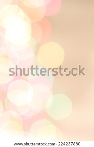 Blurred colored lights on beige background