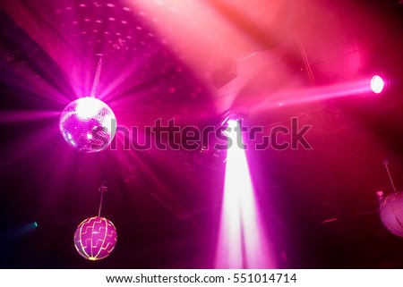 Blurred colorful laser lights with vintage disco ball - Defocused image -Concept of nightlife with music,drink and entertainment - Original color bokeh - Warm filter