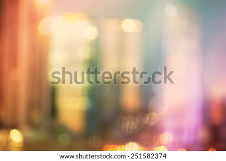 Blurred colorful urban building background scene with bokeh lights - stock photo