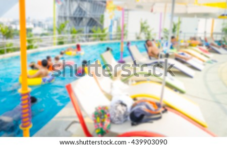 Blurred colorful water park. Swimming pool playground. Amusement park.