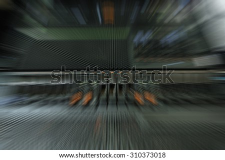 Blurred Computer Server and raid storage in datacenter - stock photo