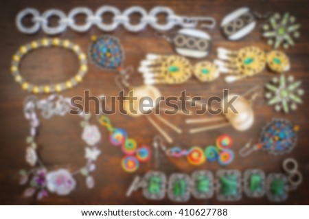 Blurred costume jewelry. Earrings, necklaces, bracelets. Accessories for women.  Blur backgrounds concept. - stock photo