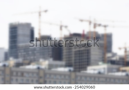 Blurred crane and building construction site as background - stock photo