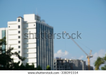 Blurred crane and building construction site as background