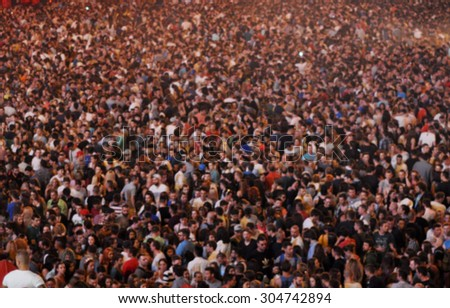 Blurred crowd at a concert - stock photo