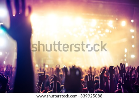 Blurred crowd hands celebrating their favorite dj or band. Soft focus. - stock photo
