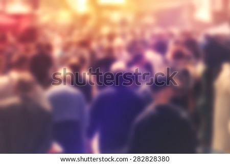 Blurred Crowd of People On Street, unrecognizable crowded population as blur urban background, Vintage Toned Image. - stock photo