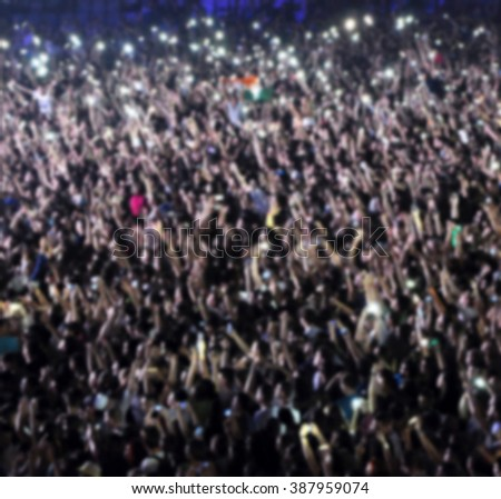 Blurred crowd of people partying - stock photo