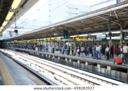 Blurred Crowd of People waiting for the train