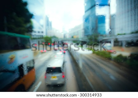 Blurred crowded city background with vintage color tone tuned