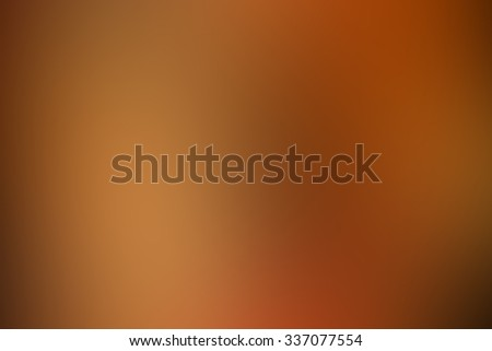 blurred dark orange colour backdrop wallpaper:abstract blur color backgrounds for decorate festival concept. - stock photo