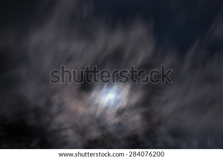 Blurred - dark sky with moon - stock photo