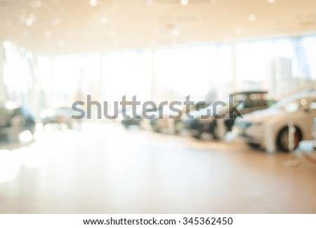 Blurred dealership store, with the cars and soft lightning - stock photo