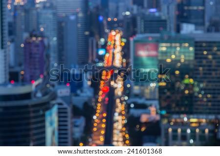 Blurred Defocused Big City Lights of Heavy Traffic at Night  - stock photo