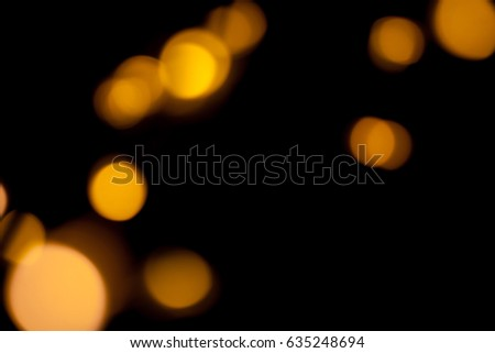Blurred defocused bokeh lights on black background