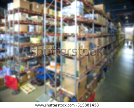 Blurred defocused image of warehouse with many boxes and goods